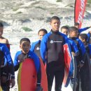 Lamberts Bay local kids receiving wetsuits and boards for body boarding